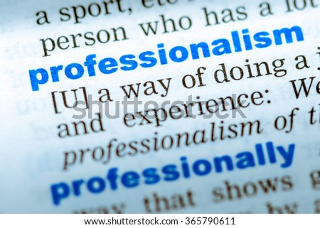 Close-up of word in English dictionary. Professionalism, definition and transcription