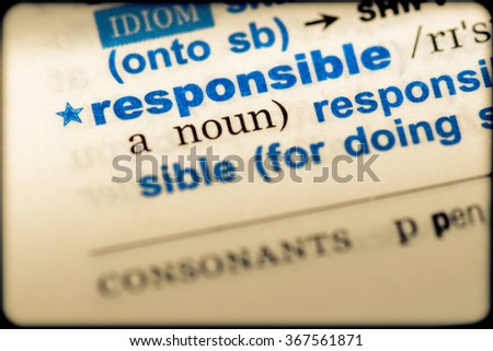 Close-up of word in English dictionary. Responsible, definition and transcription