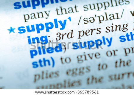 Close-up of word in English dictionary. Supply, definition and transcription