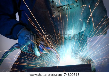 Close up of worker welding steel - a series of METAL INDUSTRY images. - stock photo