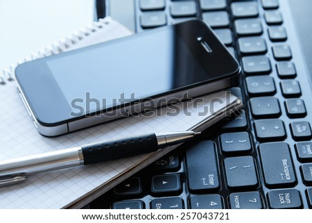 Close up of workplace in office - stock photo