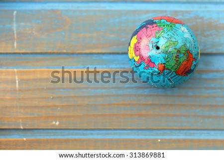 Close up of world globe - showing Asia and America side of world - top view - travel destination and love different cultures concept - place for text - stock photo
