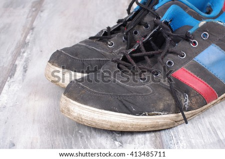 Close up of worn sweaty sneakers with copy space - stock photo