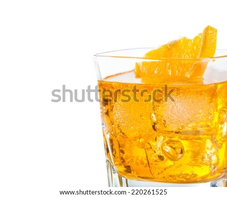 close-up of yellow cocktail with orange slice isolated on white background with space for text, focus on slice