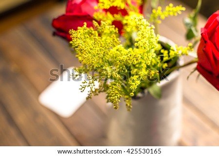 close-up of yellow flower in living room