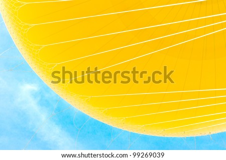 Close up of yellow hot air balloon on blue sky background - stock photo