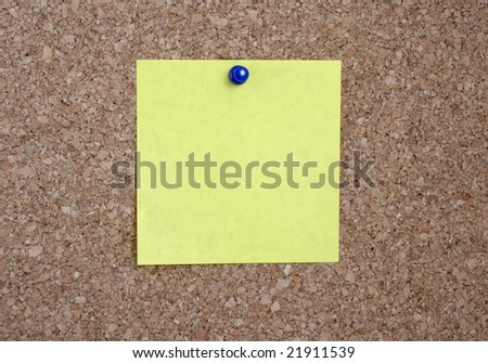 close up of yellow note pad reminder on wall