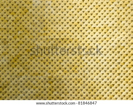 Close-up of yellow stone wall with triangle shadow - stock photo