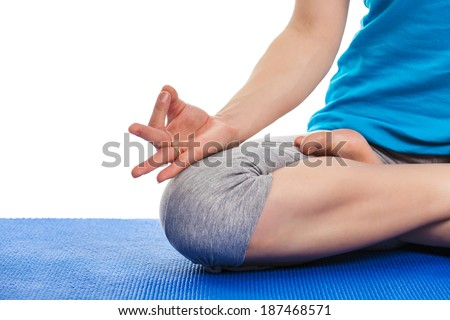 Close up of yoga Padmasana (Lotus pose) cross legged position for meditation with Chin Mudra - psychic gesture of consciousness - stock photo