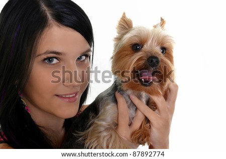 Close-up of young adult female with Yorkshire Terrier dog