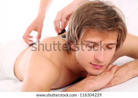Close up of Young and handsome guy relaxing at massage session