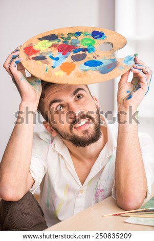 Close-up of young artist with mix color oil painting on palette. - stock photo