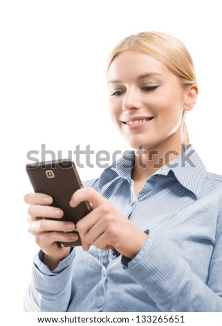 Close up of young attractive blonde woman using smart phone isolated on white background - stock photo