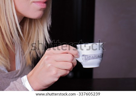 Close up of young attractive woman drinking coffee in cafeteria. Businesswoman on coffee break  - stock photo