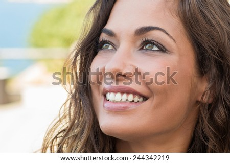 Close Up Of Young Beautiful Woman Daydreaming and Smiling In Summer Time  - stock photo