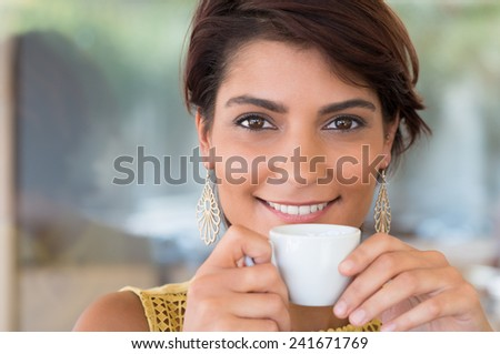 Close Up Of Young Beautiful Woman Holding Cup Of Coffee At Bar  - stock photo