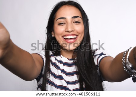 Close-up of young beautiful woman taking selfie. Isolated white background - stock photo