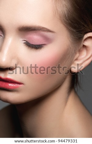Close-up of young beautiful woman with closed eyes with beautiful make-up