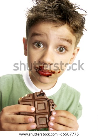 Close Up of Young Boy Eating A chocolate bar. - stock photo