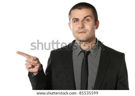 Close up of young business man pointing at copy space over white background - stock photo