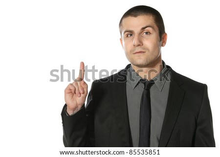 Close up of young business man pointing up at copy space over white background - stock photo