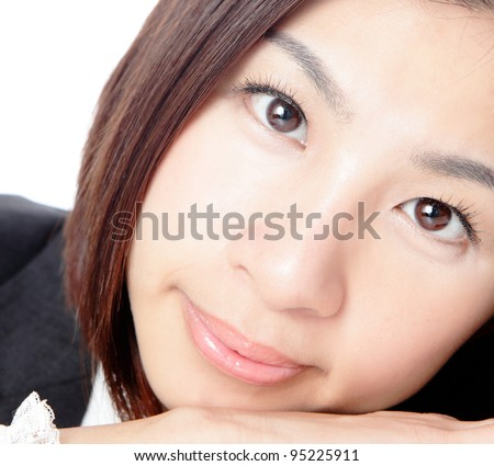 Close up of young business woman giving you attractive smile isolated on white background, model is a asian beauty - stock photo