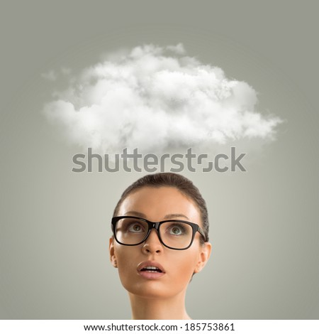 Close up of young business woman looking up for thought bubble above her head with copy space