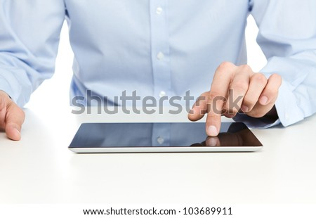 Close up of young businessman using digital tablet - stock photo