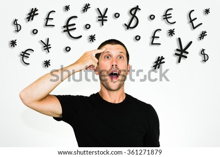 Close up of young caucasian man having a good idea to make money, with black tshirt isolated on white background, with simbols of world's values: dollar, euro, yen, pound sterling - stock photo