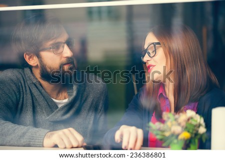 Close Up Of Young Couple Enjoying In Cafe - stock photo