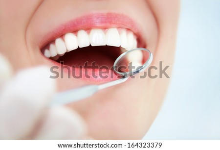 Close-up of young female having her teeth treats - stock photo