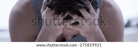 Close-up of young frustrated man after sleepless night - stock photo