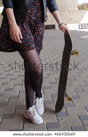 Close up of young girl with the skateboard