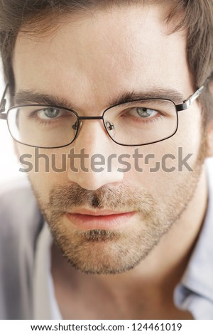 Close-up of young handsome man wearing fashion eyeglasses - stock photo