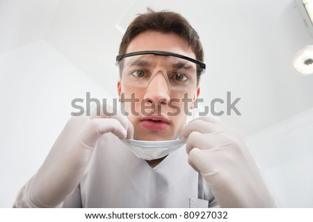 Close-up of young male dentist wearing mask