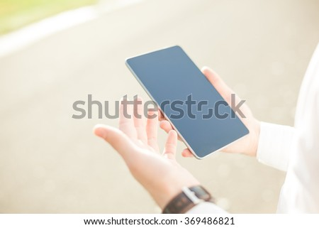 Close up of young man hands using touchscreen on digital tablet - stock photo