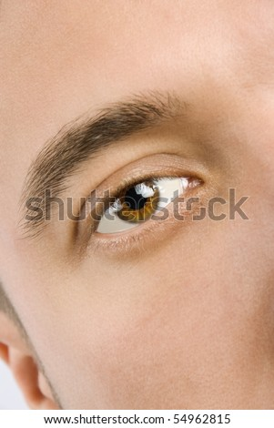 Close up of young man's brown eye and face skin - stock photo