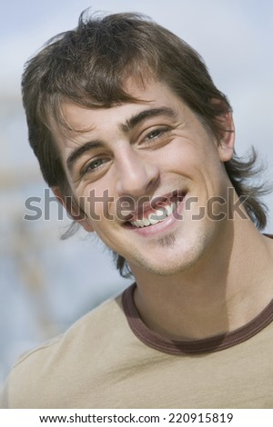 Close up of young man smiling - stock photo