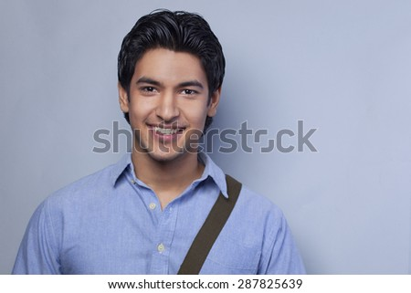 Close-up of young man smiling - stock photo