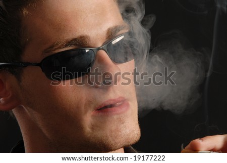 Close-up of young man smoking