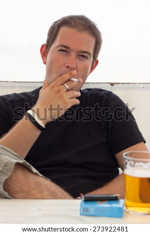 Close up of young man smoking cigarette.