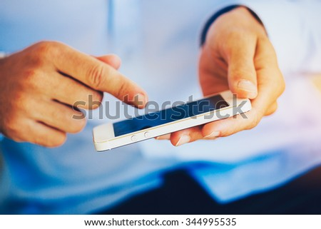 Close up of Young Man Using Mobile Smart Phone - stock photo