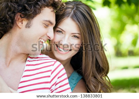 Close-up of young romantic couple on a sunny day in the park.