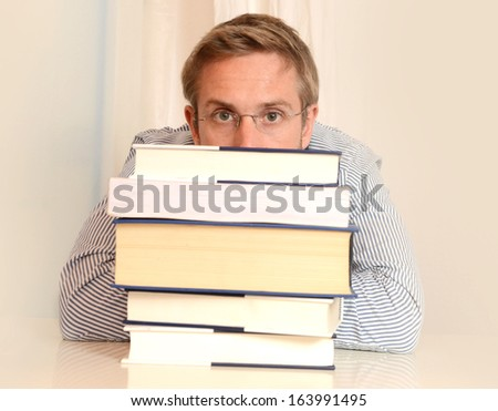 Close up of Young Student Stressed and Overwhelmed wearing glasses - stock photo