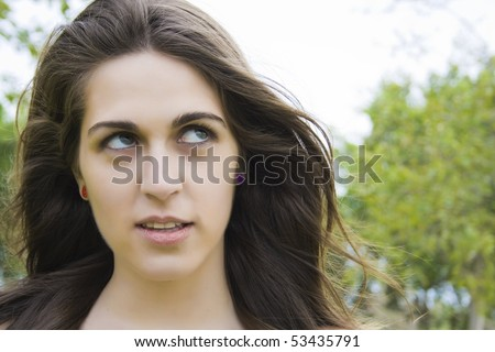 Close up of young woman looking up surprised gesture - stock photo