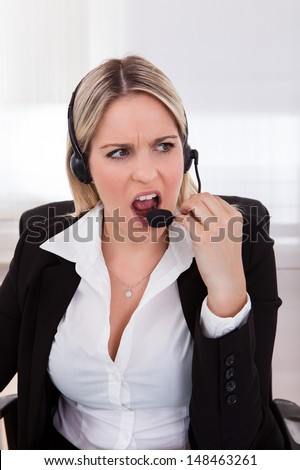 Close-up Of Young woman Operator With headset - stock photo