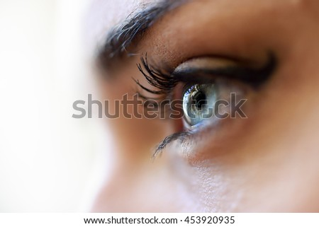 Close-up of young woman's blue eyes with long eyelashes. Make-eye - stock photo