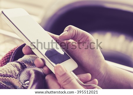 Close up of young woman using a smartphone,Social Media Life