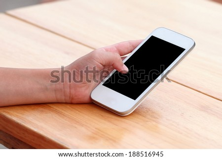 Close up of young woman using her mobile smart phone - stock photo