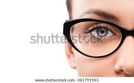 Close up of young woman wearing eyeglasses isolated on white background with copy space - stock photo